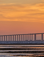 Sun rising under the Sunshine Skyway bridge from Fort De Soto Park. Print copy 2 of 5 images taken with a Fuji X-H1 camera and 200 mm f/2 OIS lens with a 1.4x teleconverter (ISO 400, 280 mm, f/16, 1/80 sec). Raw images processed with Capture One Pro and AutoPano Giga Pro.