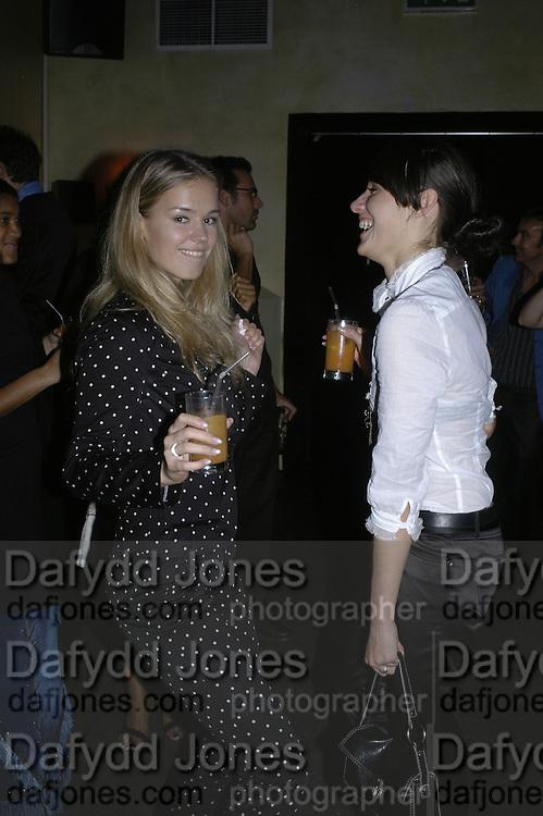 Leva Koko and Jana Uzule, Premiere party for Rabbit Fever. 68 Regent St. London 20 September 2006. ONE TIME USE ONLY - DO NOT ARCHIVE  © Copyright Photograph by Dafydd Jones 66 Stockwell Park Rd. London SW9 0DA Tel 020 7733 0108 www.dafjones.com