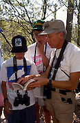 Leader Victor Emanuel, right, birding with Camp Chiricahua kids, Arizona-Sanora Desert Museum, Tucson, Arizona..Media Usage:.Subject photograph(s) are copyrighted Edward McCain. All rights are reserved except those specifically granted by McCain Photography in writing...McCain Photography.211 S 4th Avenue.Tucson, AZ 85701-2103.(520) 623-1998.mobile: (520) 990-0999.fax: (520) 623-1190.http://www.mccainphoto.com.edward@mccainphoto.com.