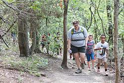 Kids hiking on trail Dogwood Canyon Audubon Center, Cedar Hill, Texas, USA.