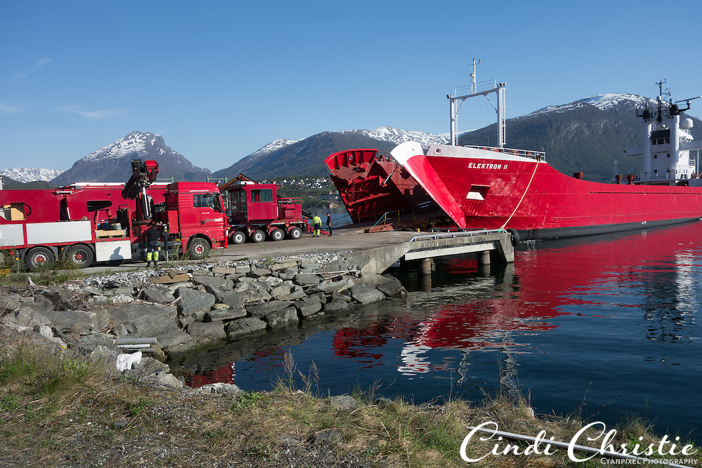 Statnett transports an electrical transformer from Sandane, Norway, to Moskog on May 18, 2013. The transport equipment arrived on the Elektron 2, a ship modified for the heavy cargo. Bridges had to be reinforced and other modifications made so they could withstand the weight of  lengthy train of vehicles carrying approximately 4,000 tons along the twisting mountain byways. (© 2013 Cindi Christie)