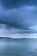 A Fall rainstorm heads towards Stanley Park in Vancouver, British Columbia, Canada