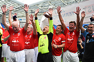 (Caption Correction) The England over 60's with Tommy Charlton of England celebrate their victory with the Just International Cup during the trophy presentation which they won 3-0 during the world's first Walking Football International match between England and Italy at the American Express Community Stadium, Brighton and Hove, England on 13 May 2018. Picture by Graham Hunt.