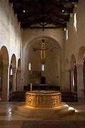 The Romanesque octagonal baptismal font in the Duomo, Verona, Italy
