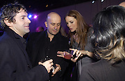Robert Delamere, Mark Quinn and Saffron Burrows. The Almeida Theatre Charity Christmas Gala, to raise funds for the theatre, at the Victoria Miro Gallery, London.  1 December  2005. ONE TIME USE ONLY - DO NOT ARCHIVE  © Copyright Photograph by Dafydd Jones 66 Stockwell Park Rd. London SW9 0DA Tel 020 7733 0108 www.dafjones.com