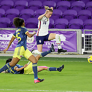 ORLANDO, FL - JANUARY 22:  Emily Sonnett #14 of United States leaps over a sliding Carolina Arias #17 of Columbia as Jorelyn Carabali #16 of Columbia gives chase at Exploria Stadium on January 22, 2021 in Orlando, Florida. (Photo by Alex Menendez/Getty Images) *** Local Caption *** Emily Sonnett; Carolina Arias; Jorelyn Carabali