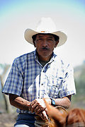 A guide waits with his horse  for tourists who want to ride up Volcan de Pacaya. San Francisco de Sales. Republic of Guatamala. 02Mar14
