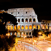 ROME, Italy - A shot at night of the famous Coliseum of Rome under lights.