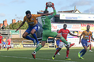 Dillon Phillips of Charlton Athletic (1) claims the ball before Malvind Benning of Mansfield Town (3) gets a header in during the The FA Cup match between Mansfield Town and Charlton Athletic at the One Call Stadium, Mansfield, England on 11 November 2018.