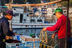 Fishermen preparing their gear at Heda Port on the Izu Peninsula, Japan.