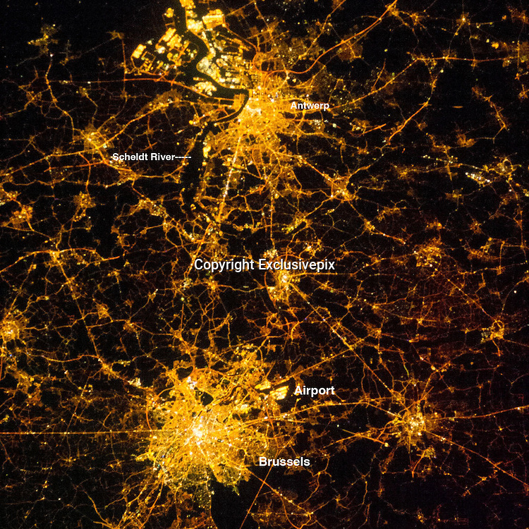 CITYS BY NIGHT<br /> <br /> Brussels and Antwerp at Night<br /> <br /> An astronaut on the International Space Station took this night photograph of two of Belgium'Äs major metropolitan areas. Antwerp is a major European port located on the Scheldt River, which appears as a black line angling through the lights. The city has access to the Atlantic Ocean, and its extensive dock facilities are even more brightly lit than the city center.<br /> Brussels is the capital and largest city in Belgium, and also the de facto headquarters of the European Union. Brilliant points of light are the city center and the Brussels National Airport. Developed roadways appear as straighter, brighter lines radiating from the two cities.<br /> About a minute before this photo was taken, an astronaut captured a wider contextual view of Belgium, Netherlands, and northwest Germany. Taken with a shorter (wider-angle) lens, the photo gives a panoramic view as the ISS crossed into Europe from the Atlantic Ocean.<br /> ©Earth Observatory/Exclusivepix