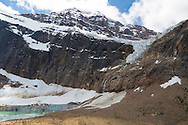 Mount Edith Cavell is a mountain located in the Athabasca River and Astoria River valleys of Jasper National Park, Canada, and the most prominent peak entirely within Alberta.