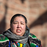 Navajo Council delegate Amber Crotty gives an impassioned speech on the issue of human trafficking in from of council chambers in Window Rock Monday. Crotty helped lead a march from Wells Fargo to the council chambers Monday morning to help raise awareness of the issue.