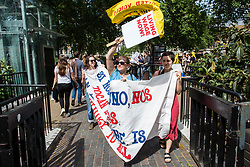 London, UK. 1 June, 2019. Members of the United Voices of the World (UVW) and Independent Workers of Great Britain (IWGB) and  grassroots trade unions meet in Cavendish Square before a protest inside the DoubleTree Hilton Hotel in solidarity with Dalia Quinonez Guerrero, a former cleaner from whom wages were withheld. The protest was previously arranged to have taken place outside Chanel but arrangements were changed after the global fashion chain agreed to pay its cleaners the London Living Wage at its stores.