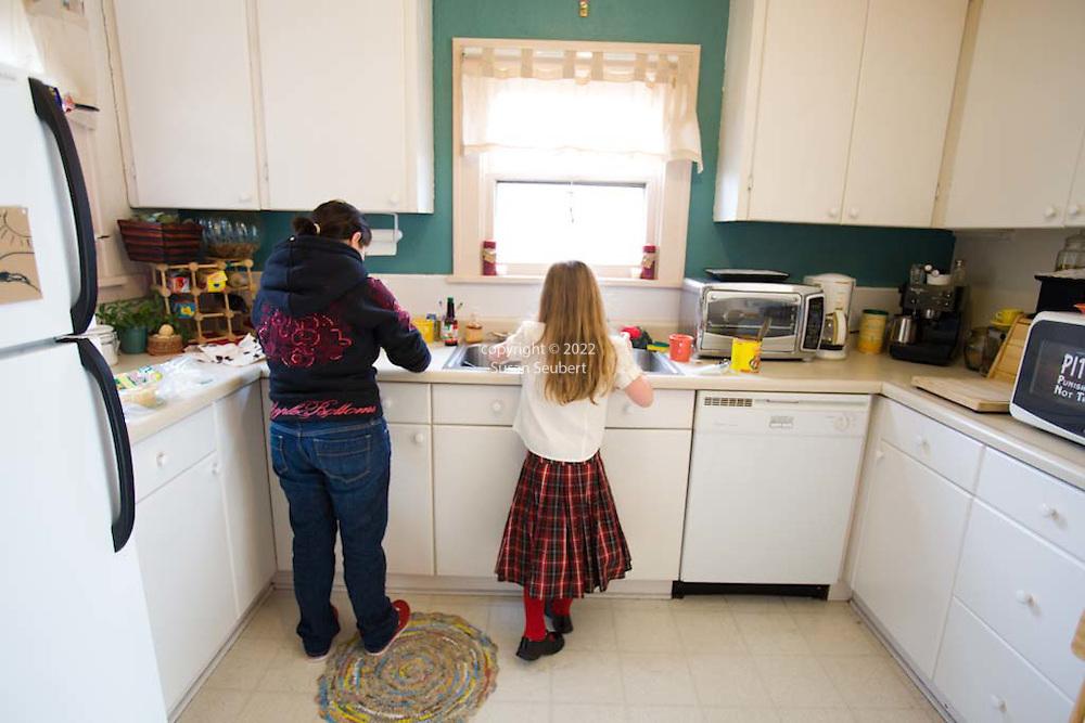 Margaret B. Jones preparing enchiladas with her daughter Rya Hickey in Margaret's kitchen in Eugene, Oregon
