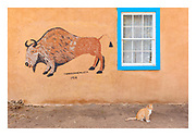 Goldie the cat under mural painted by Taos Pueblo artist Trinidad Archuleta in 1934 on D.H. Lawrence's house in San Cristobal.