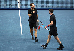 Bruno Soares (left) and Jamie Murray react during their doubles match during day two of the NITTO ATP World Tour Finals at the O2 Arena, London.