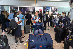 Licensed to London News Pictures. 09/08/202. London, UK. Tokyo Olympic medalists are greeted by their families and friends at London Heathrow Terminal 5 as Team GB celebrate 22 gold medals in one of the most successful Olympics on record. Photo credit: Alex Lentati/LNP