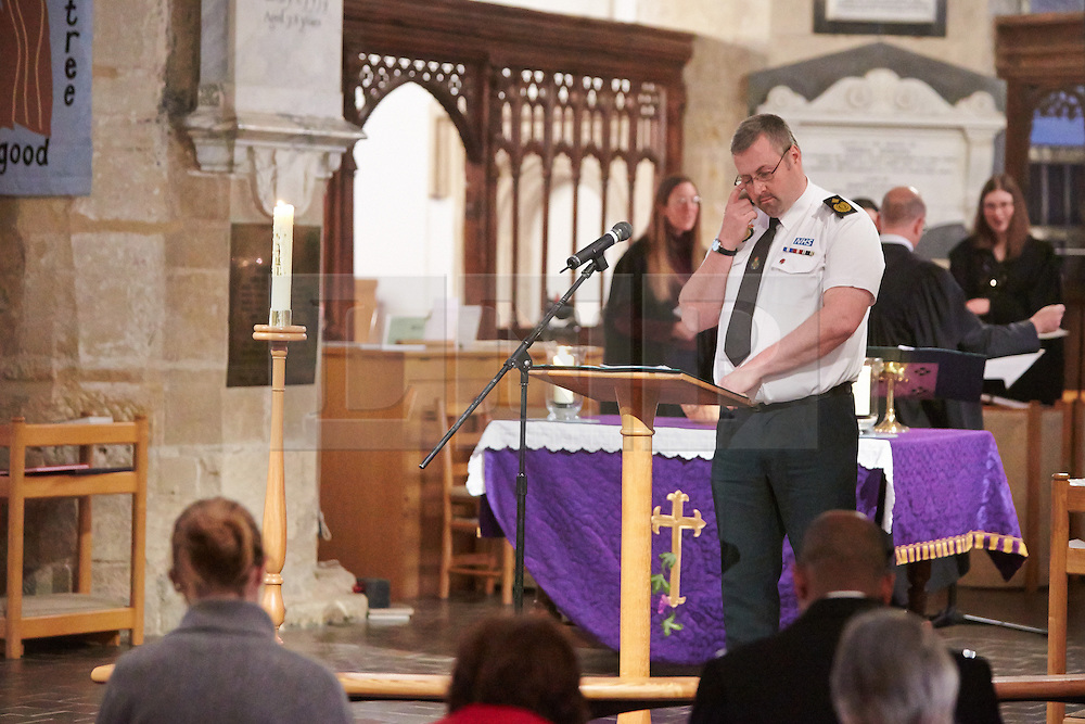 © Licensed to London News Pictures.  17/11/2013. THAME, UK. SCAS emergency services manager Andrew Battye leads a prayer during the annual Road Deaths Memorial Service held in St Marys Church, Thame. 78 people were killed in traffic accidents in the Thames Valley Police area last year.  Photo credit: Cliff Hide/LNP
