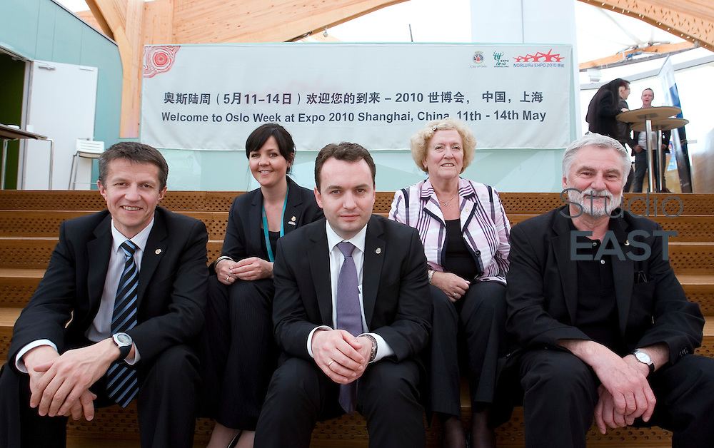 Governing Mayor of Oslo Stian Berger Rosland (center) and others pose for a photograph during 'Oslo Week', on Norwegian Pavilion, part of Shanghai World Expo 2010, in Shanghai, China, on May 14, 2010. Photo by Lucas Schifres/Pictobank