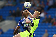 Frederic Gounongbe © has his head grabbed by Reading's Paul McShane (5) as they both jump foe a header.EFL Skybet championship match, Cardiff city v Reading at the Cardiff city stadium in Cardiff, South Wales on Saturday 27th August 2016.<br /> pic by Andrew Orchard, Andrew Orchard sports photography.