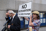 As, supporters of Wikileaks founder Julian Assange protest outside Londons Old Bailey court as his fight against extradition to the US has resumed, his father Richard Assange gives interviews on 7th September 2020, in London, England. Assange has been in Belmarsh Prison for 16 months and is wanted over the publication of classified documents in 2010 and 2011. If convicted in the US, he faces a possible penalty of 175 years in jail.