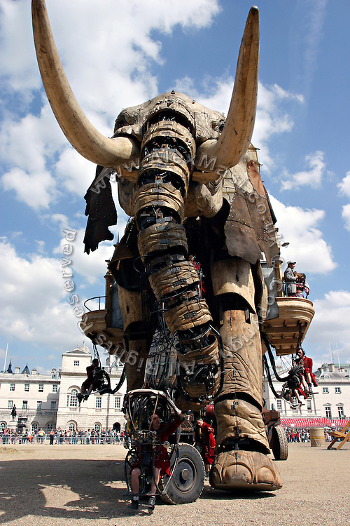 The gigantic mechanical elephant walking through his arena in central London, on Friday, May 5, 2006. The Sultan's Elephant show, for the first time in London is a magical, and unique in the world, theatrical show across the streets, performed by an international French company - Royal De Luxe - specialised in constructing and giving 'life' to enormous mechanical puppets. The Sultan's Elephant is the story of a Sultan dreaming of a little girl that travels through time. **ITALY OUT**