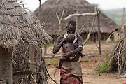 Karo tribe female with baby. Omo Valley, Ethiopia