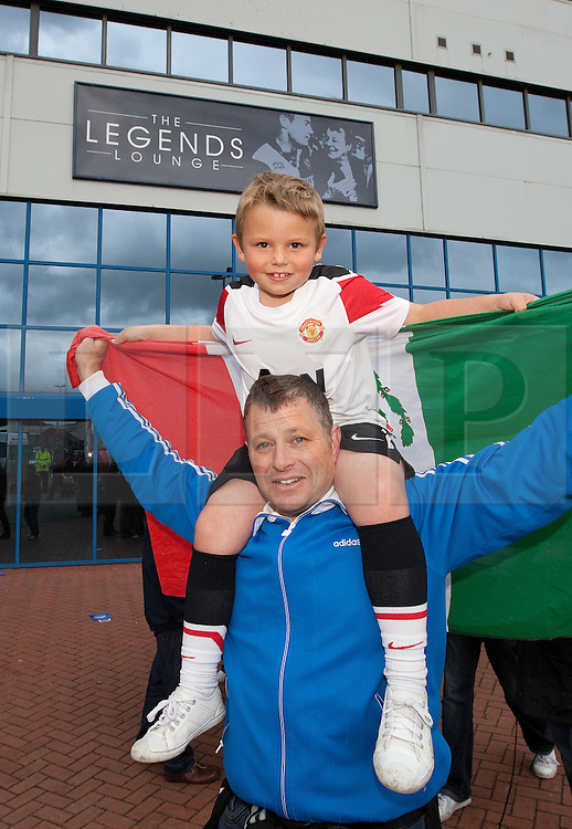 © licensed to London News Pictures. Blackburn, UK 14/05/2011.  Darren Waterhouse, 41, from Blackpool and his 7 year old son Joseph, celebrate Manchester United's Premiership victory. Jubilant Manchester United fans celebrate winning the Premiership for the 19th time, after drawing their match against Blackburn. Please see special instructions for usage rates. Photo credit should read Joel Goodman/LNP