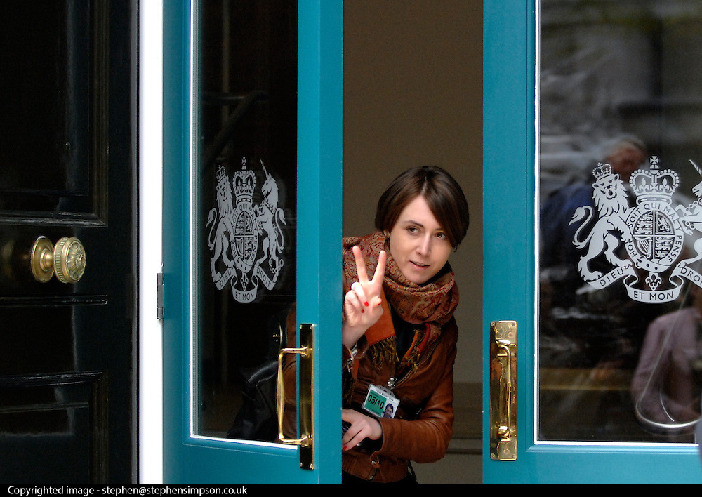 © Licensed to London News Pictures. 18/11/2012. FILE PICTURE DATED 10 May 2010. Poppy Mitchell-Rose gives waiting journalists a two minute warning after coalition talks at the Cabinet Office after a hung election. George Osborne's long serving aide Poppy Mitchell Rose is leaving the Chancellor's office to work in the private sector in America. She is to be replaced by Thea Rogers.   Photo credit : Stephen Simpson/LNP