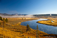 The Yellowstone River snakes through the Hayden Valley in Yellowstone National Park in Wyoming at sunrise