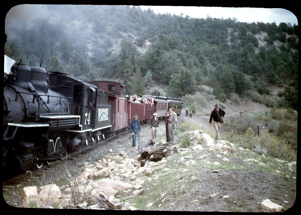 "RGS #74 with a RMRRC trip southbound with caboose #0400, two gondolas, coach #311 and ""Edna"".<br /> RGS  Pleasant Valley, CO  5/28/1949<br /> Companion photos at RD125-070, RD125-088, RDS018-002, RDS075-080 and RDS079-091.<br /> Thanks to Don Bergman for additional information."