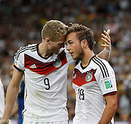 Germany's Mario Götze celebrates scoring their first goal with team mate André Schurrle during the 2014 FIFA World Cup Final match at Maracana Stadium, Rio de Janeiro<br /> Picture by Andrew Tobin/Focus Images Ltd +44 7710 761829<br /> 13/07/2014