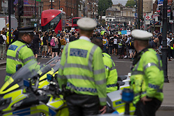 © Licensed to London News Pictures. 08/08/2020. London, UK. Member of the Metropolitan Police look at Black Lives Matter protestors outside Tottenham Police Station in north London. Photo credit: Marcin Nowak/LNP