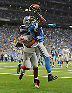 DETROIT, MI - SEPTEMBER 08: Calvin Johnson #81 of the Detroit Lions can't make a catch in front of Antrel Rolle #26 of the New York Giants during the third quarter at Ford Field on September 8, 2014 in Detroit, Michigan. (Photo by Joe Sargent/Getty Images) *** Local Caption ***Calvin Johnson;Antrel Rolle