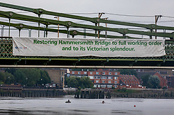 © Licensed to London News Pictures. 14/08/2020. London, UK. Rowers keep away from Hammersmith Bridge which crosses the River Thames in West London after Fulham Council suddenly closed it to all traffic Thursday night due to safety concerns. Hammersmith Bridge has been close to all traffic including pedestrians, cyclists and boats going under it after cracks in the bridge have become larger by the heatwave. Photo credit: Alex Lentati/LNP