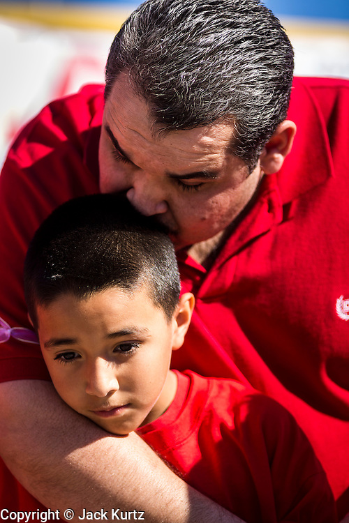05 OCTOBER 2013 - PHOENIX, ARIZONA: A man and his son at an immigration rally in Phoenix. More than 1,000 people marched through downtown Phoenix Saturday to demonstrate for the DREAM Act and immigration reform. It was a part of the National Day of Dignity and Respect organized by the Action Network.   PHOTO BY JACK KURTZ