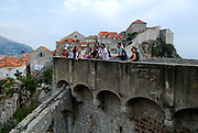 Group of tourists on section of city wall, Dubrovnik old town, Croatia