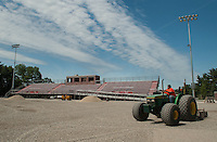 Crews do prep work on the Laconia High School football field prior to the turf installation on Friday morning.  (Karen Bobotas/for the Laconia Daily Sun)