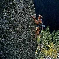 """ROCK CLIMBING. Alex Lowe (MR) on """"Cardiac Arete"""", (5.12), Hyalite Canyon, near Bozeman, MT."""