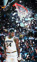 Ann Arbor, MI -- University of Michigan's Robert Traylor destroys a backboard during game against Ball State. Photo by Jack Gruber