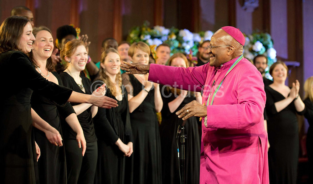 Former archbishop Desmond Tutu dances at a ceremony after receiving the 2013 Templeton Prize at the Guildhall in London, UK. South African anti-apartheid campaigner Desmond Tutu won the 2013 Templeton Prize worth $1.7 million for helping inspire people around the world by promoting forgiveness and justice.
