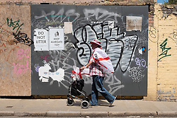 © Licensed to London News Pictures. 13/06/2021. London, UK. A England football fan walks along a street in Margate, Kent ahead of the Euro 2020 football match between England and Croatia. The UK is currently experiencing an extended hot weather period. Photo credit: Ray Tang/LNP