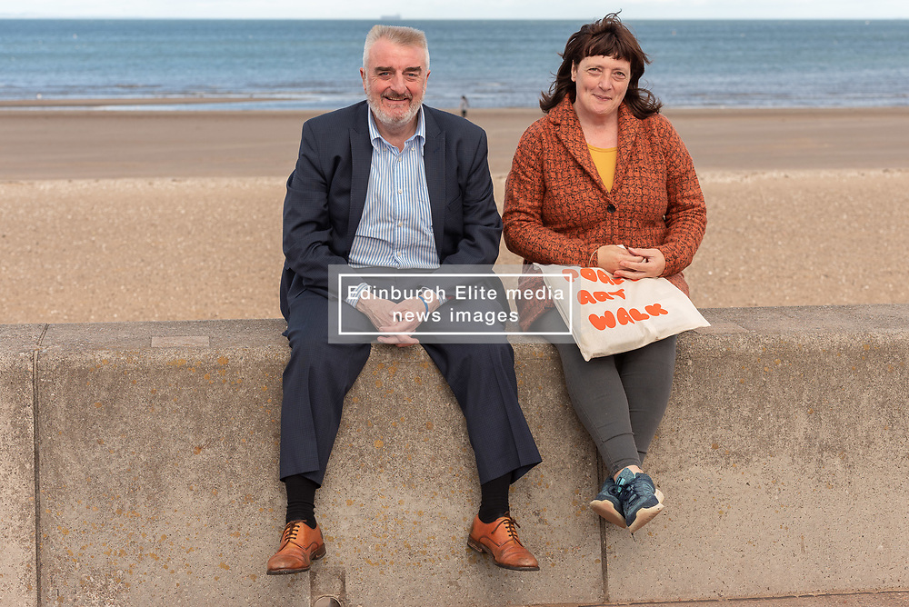 Art Walk Porty founder and producer Rosy Naylor shows local MP Tommy Sheppard around some of the work and meets some of the artists in this year's Art Walk in Portobello. Pictured:<br /> Rosy Naylor and Tommy Sheppard MP on the Prom © Jon Davey/ EEm