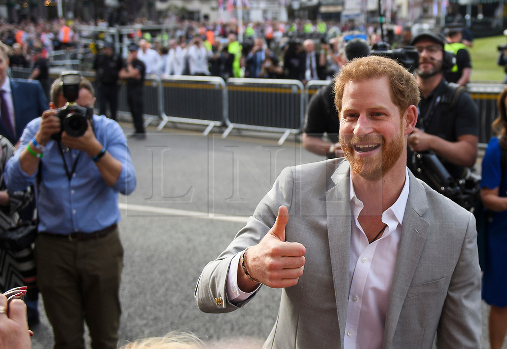 © Licensed to London News Pictures. 18/05/2018. London, UK. PRINCE HARRY on a walkabout outside Windsor Castle on the eve of the wedding of Prince Harry to Meghan Markle.. Prince Harry and Meghan Markle are to be married tomorrow (Saturday) at St George's Chapel in Windsor. Photo credit: Ben Cawthra/LNP