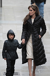 Please hide the child's face prior to the publication - Exclusive - Angelina Jolie and Maddox during the set of The Tourist in Paris, France on In Paris, France on February 25, 2010. Photo by ABACAPRESS.COM  | 563974_003 Paris France