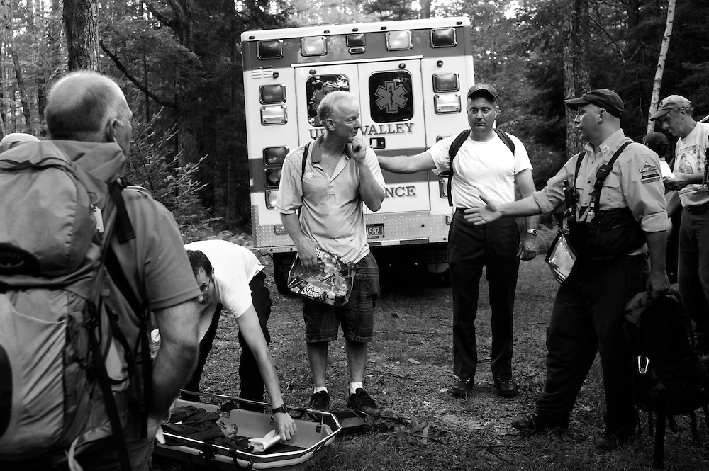 """After the two-hour descent from Mount Cube in Orford, N.H., Bob Brownell thanks the group of paramedics, volunteers and hikers who helped his injured wife, including Sgt. Brian Suttmeier of New Hampshire Fish and Game, second from right, and Tom Bourgoine, right, of the Upper Valley Wilderness Response Team. """"Bless these folks,"""" Brownell said of the rescuers.<br /> Valley News - James M. Patterson<br /> jpatterson@vnews.com<br /> photo@vnews.com"""