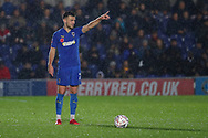 AFC Wimbledon defender Luke O'Neill (2) standing with ball at his feet and pointing during the The FA Cup match between AFC Wimbledon and Doncaster Rovers at the Cherry Red Records Stadium, Kingston, England on 9 November 2019.