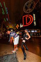 Tourist getting S&M demo, Fremont Street Experience, Downtown Las Vegas, Nevada USA.