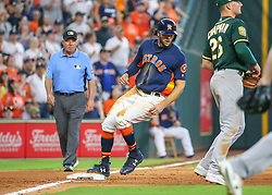 April 29, 2018 - Houston, TX, U.S. - HOUSTON, TX - APRIL 29:  Houston Astros center fielder Jake Marisnick (6) gets to third base after a throwing error by Oakland Athletics relief pitcher Ryan Dull (66) in the bottom of the seventh inning during the baseball game between the Oakland Athletics and Houston Astros on April 29, 2018 at Minute Maid Park in Houston, Texas.  (Photo by Leslie Plaza Johnson/Icon Sportswire) (Credit Image: © Leslie Plaza Johnson/Icon SMI via ZUMA Press)